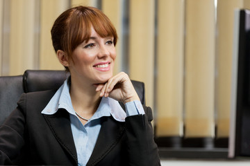 smiling female manager looking at the screen
