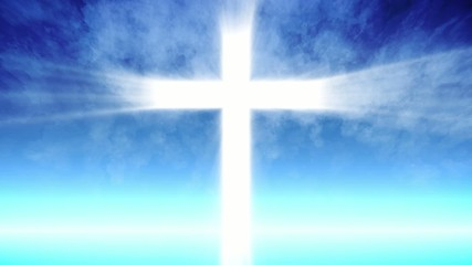 Cross of Christ ray beams and blue sky background