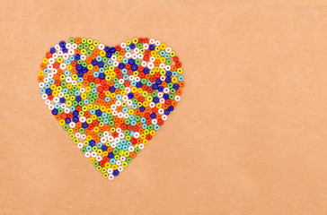 Colorful plastic beads  in heart shaped