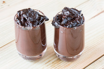 chocolate  pudding glasses on wooden board
