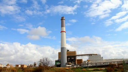 Small power plant  on blue cloudy sky background
