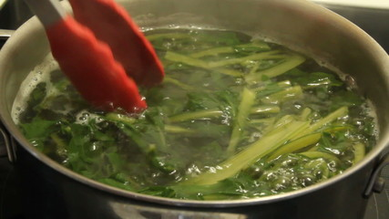 boiling dandelion flower greens real time video