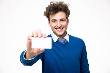 Cheerful businessman showing blank business card