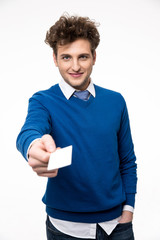 Happy  businessman showing blank business card