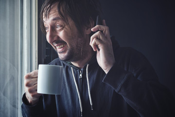 Drinking Coffee And Talking on Mobile Phone in Morning