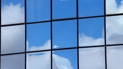 Clouds  reflection in the windows of high-rise public building