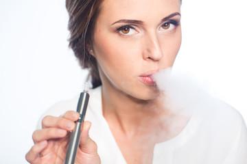 Young woman portrait with e-cigarette