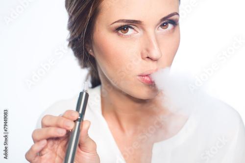 Young woman portrait with e-cigarette - 79449083