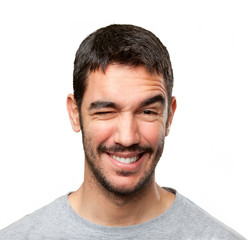 Close up of a happy man winking an eye