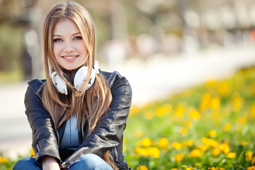 Beautiful lady are listening music on nature