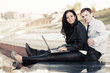Young business couple with laptop outdoor