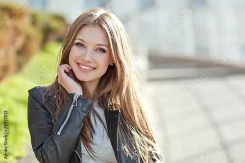 Leinwandbild Motiv Portrait Of Young Smiling Beautiful Woman