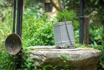 Old well with bucket.