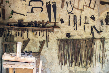 Room with pile of vintage hand tools.
