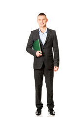 Young businessman holding his note book