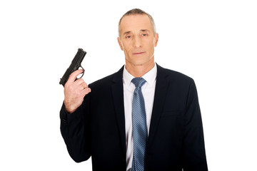Portrait of serious mafia agent with handgun