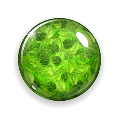 Glass button or sphere with green leaves