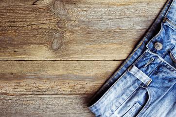 pocket jeans on wooden background