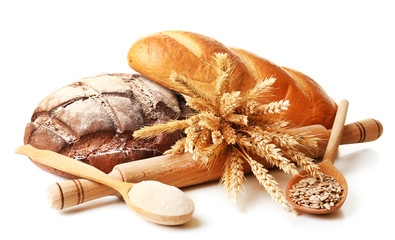 Fresh bread with wheat, flour and sunflower seeds in wooden