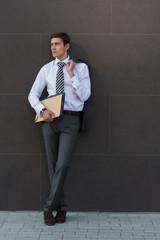 Portrait of pensive and confident adult businessman