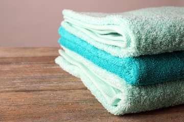 Beautiful towels on table on light background