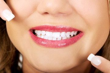 Young woman showing her perfect teeth.