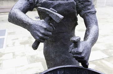 Bronze statue with a hammer