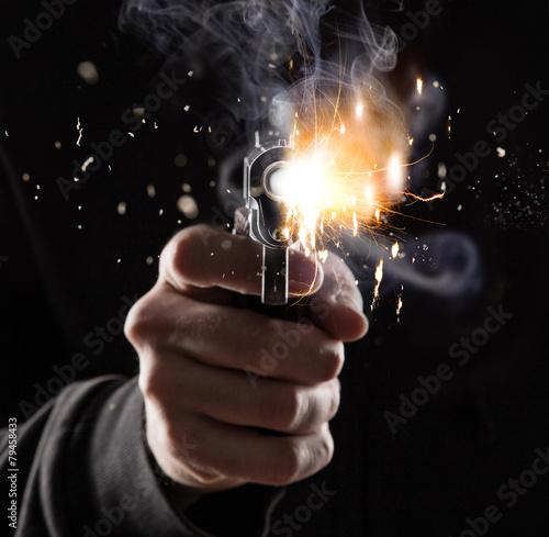Leinwanddruck Bild Killer with gun close-up