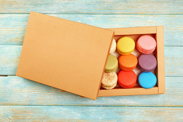 Tasty colorful macaroons in carton box