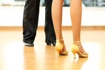 Beautiful womanish and masculine legs in active ballroom dance