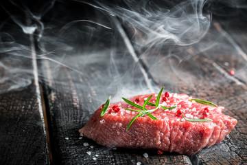 Steak on burnt table