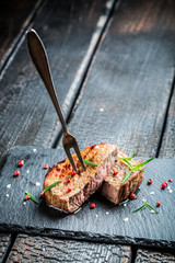 Hot grilled meat with fresh rosemary on plate