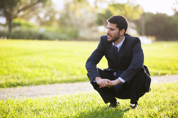 Businessman enjoying the grass smell