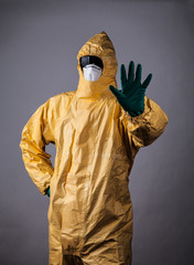 Laboratory man in chemical protective dress with gesture of reje