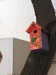 birdhouse painted on the background of the city
