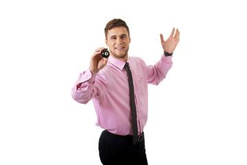 Young businessman holding billiard ball.