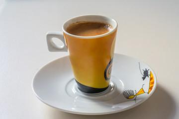 A cup of espresso coffee close up