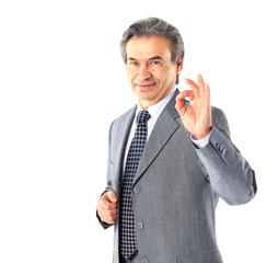 Mature businessman doing ok sign
