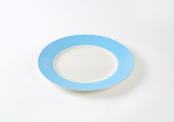 Empty white-blue dinner plate