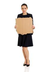 Sad businesswoman with piece of cardboard.