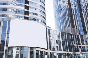 Empty billboard on futuristic office building exterior
