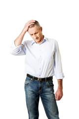 Mature man with huge headache
