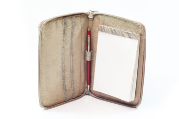 Leather bag notebook on white background.