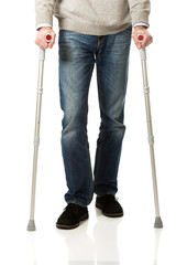 Male legs with crutches