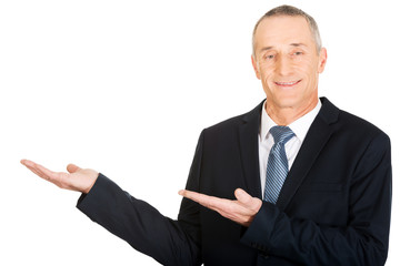 Businessman with welcome gesture