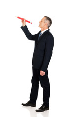Businessman with big red pencil