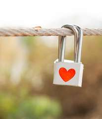 Lock with heart symbol on rope bridge as a promise of  lover