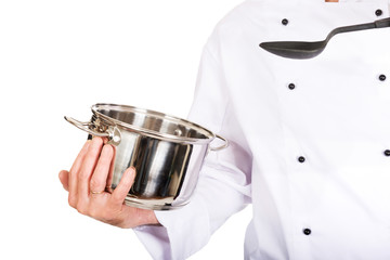Chef's hand holding stainless steel pot and spoon