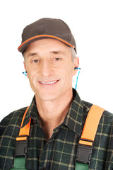 Mature worker wearing ear protectors