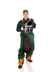 Worker in uniform with a leaf blower